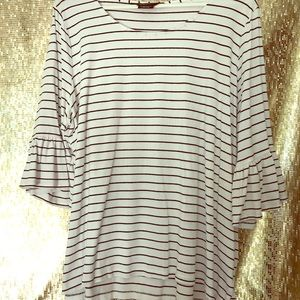 White top with black stripes and ruffled sleeves.